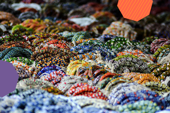 "hundreds of colourful bracelets made from colourful ghanaian beads""A"