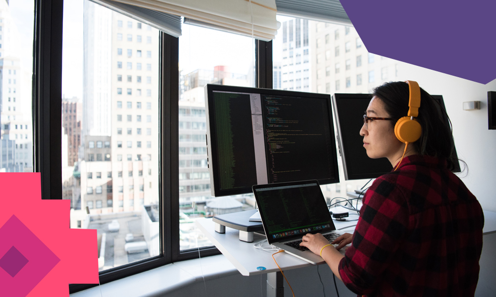 """female coder with dark short hair with monitors around her looking outside of a window""""A"""