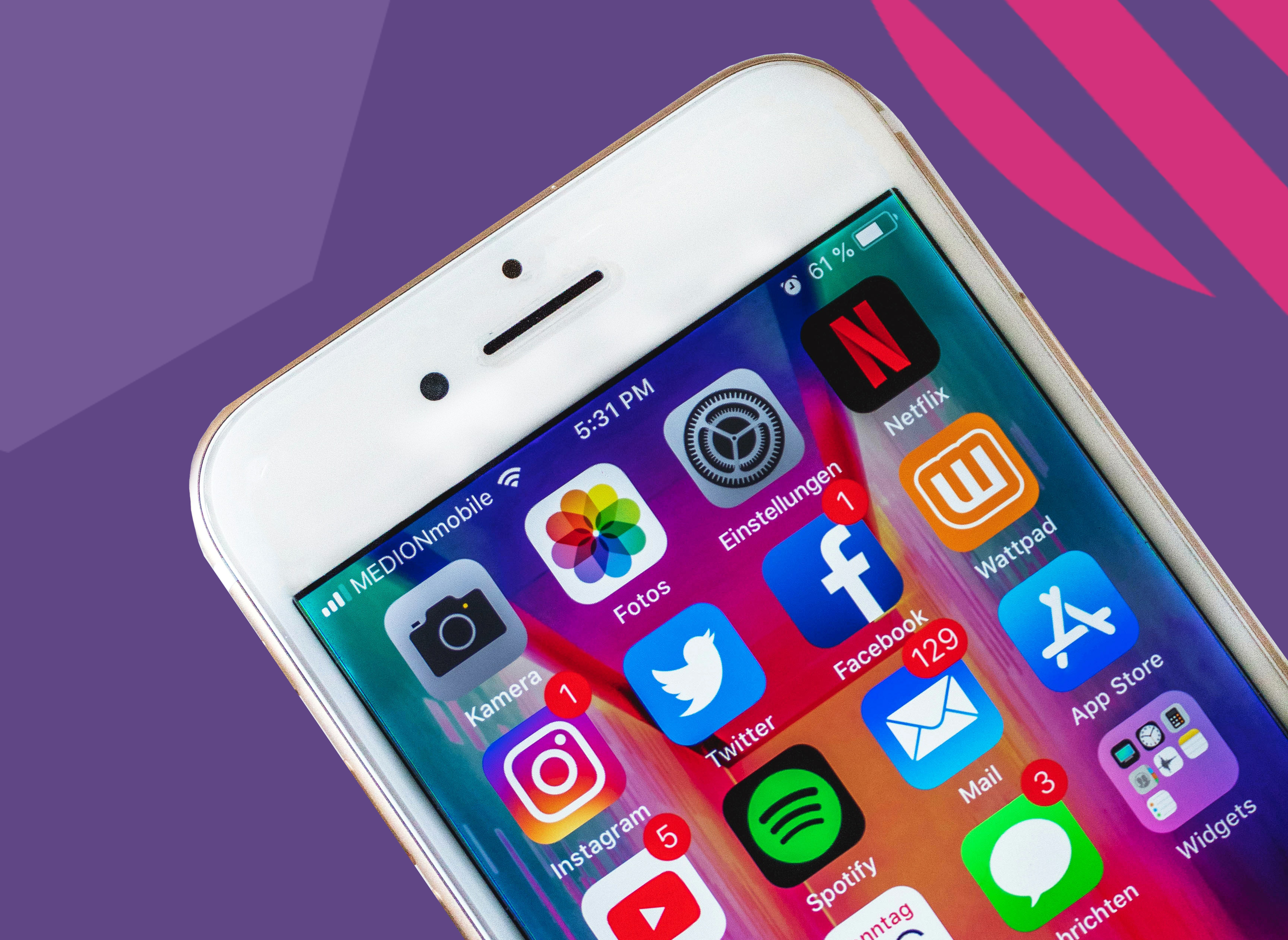 "phone on a purple background with social media apps sowing facebook""A"