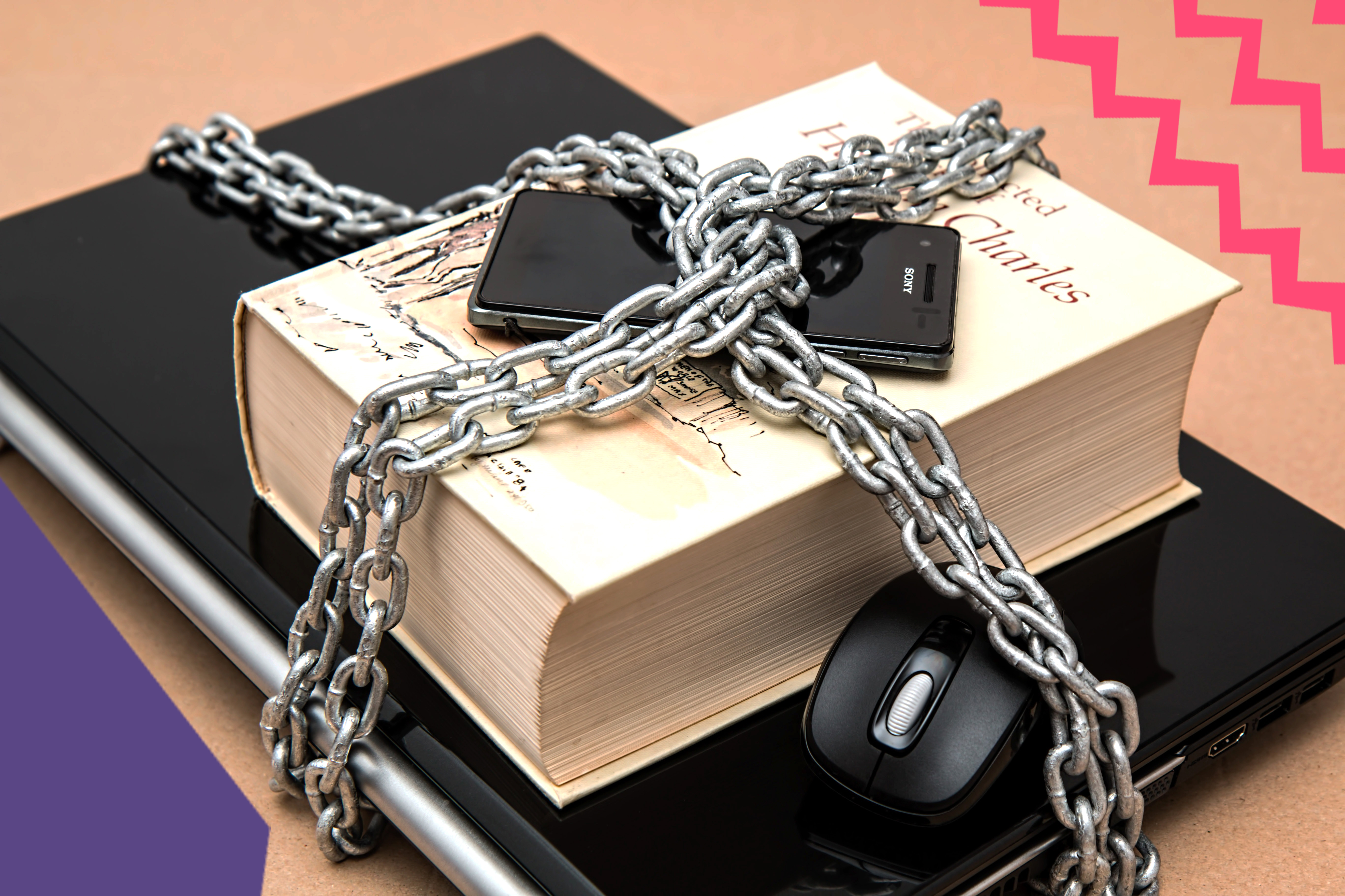"book and computer and computer mouse and a phone locked up by a chain online scam protection""A"