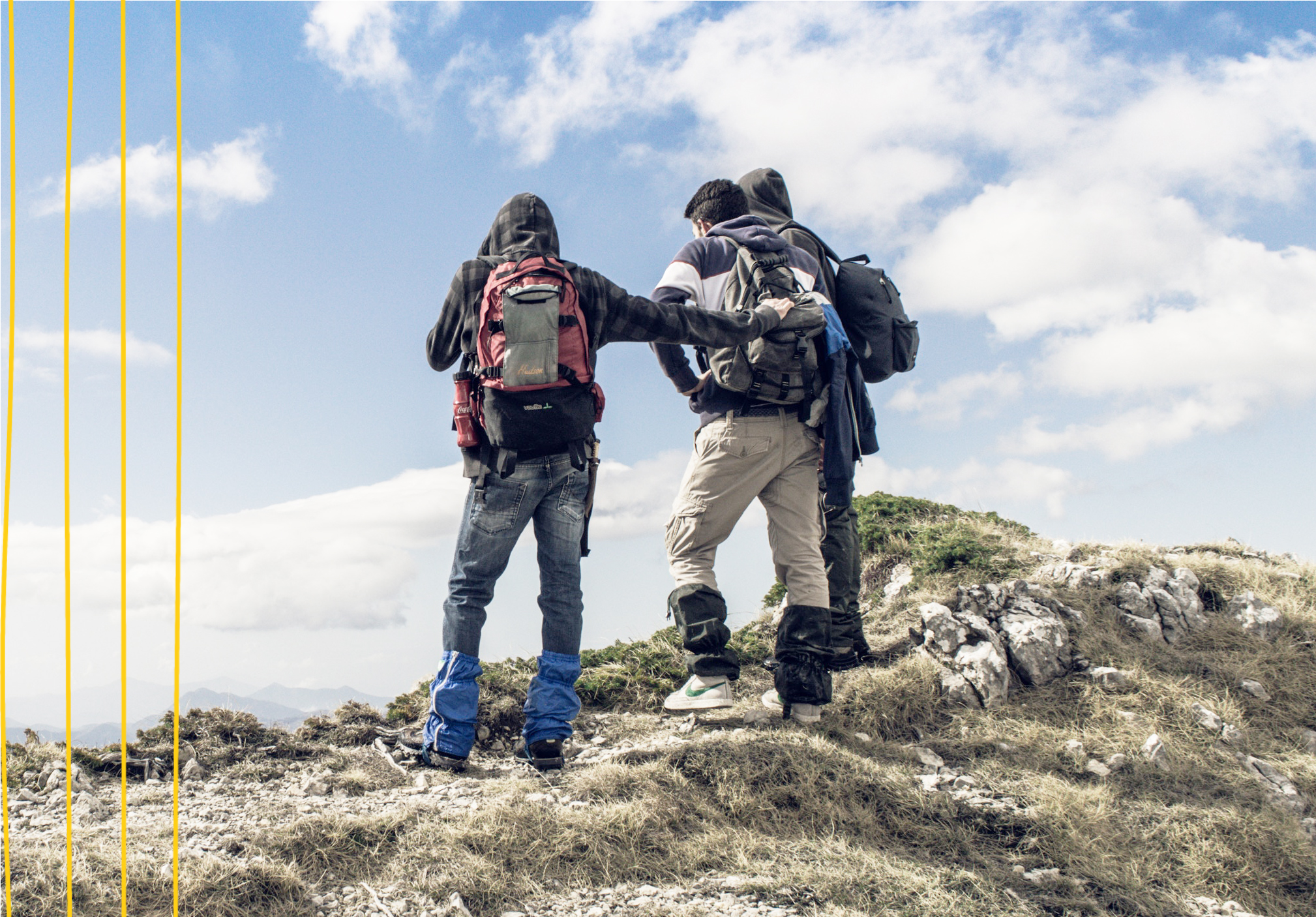 "three men backpacking and hiking on a mountain""A"