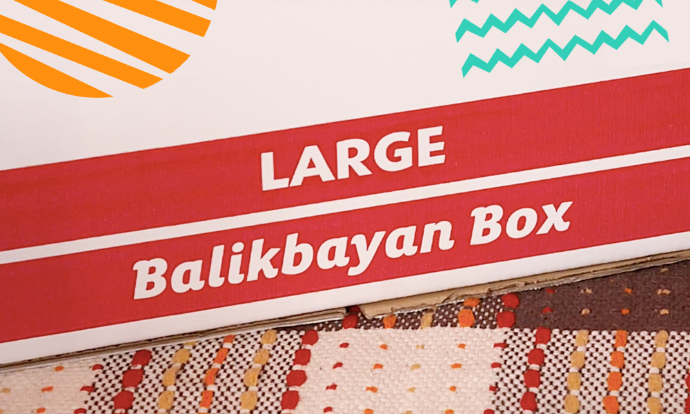 "a snippet of a balikbayan box with a red sign and colourful vectors decorations on the side""A"