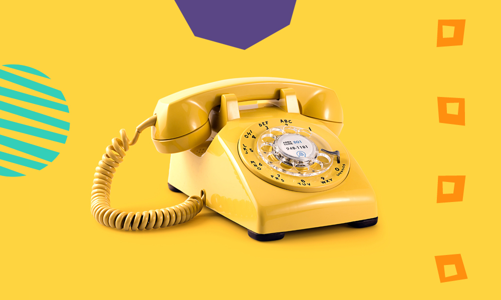"a yellow old fashioned telephone on a yellow background""A"