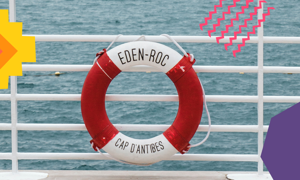"""life preserver ring on a white fence  """"A"""