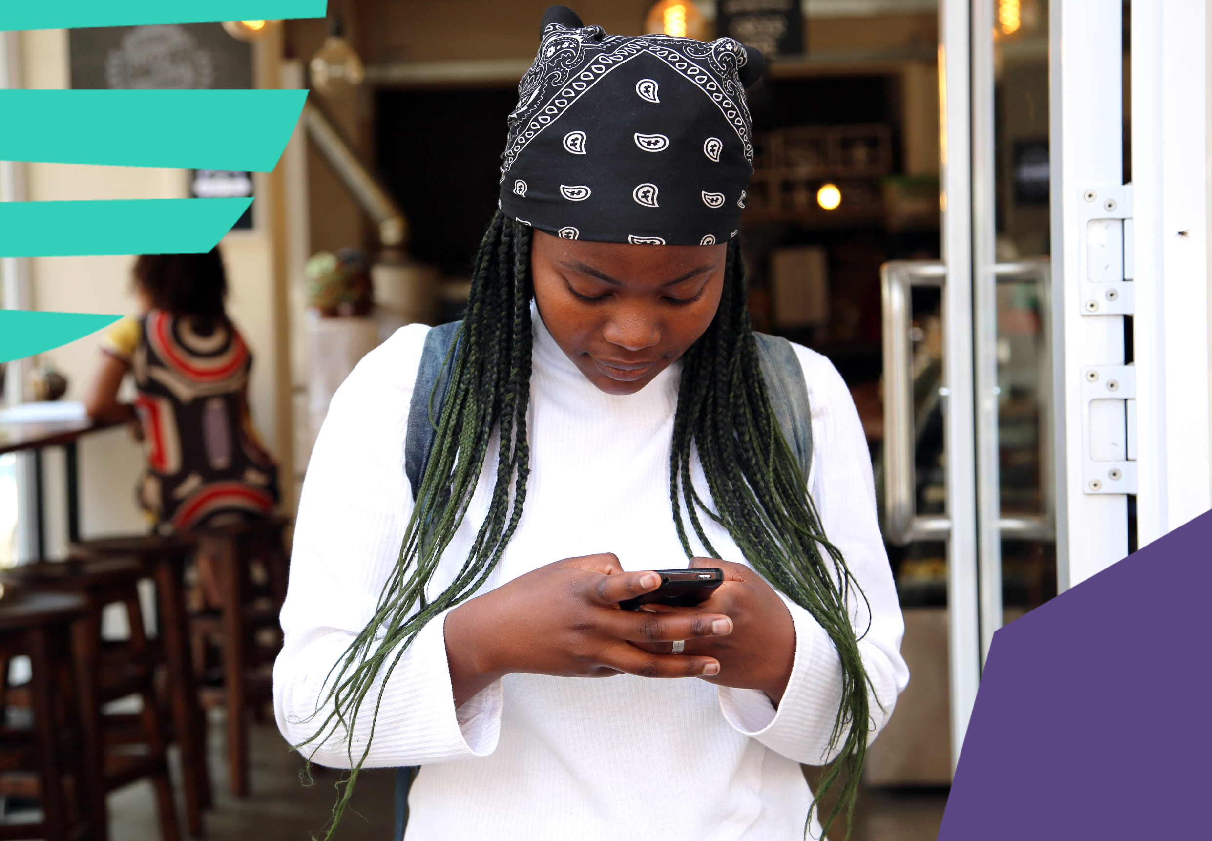 "girl in a white tshirt with long black braids and a head scarf messaging via phone""A"