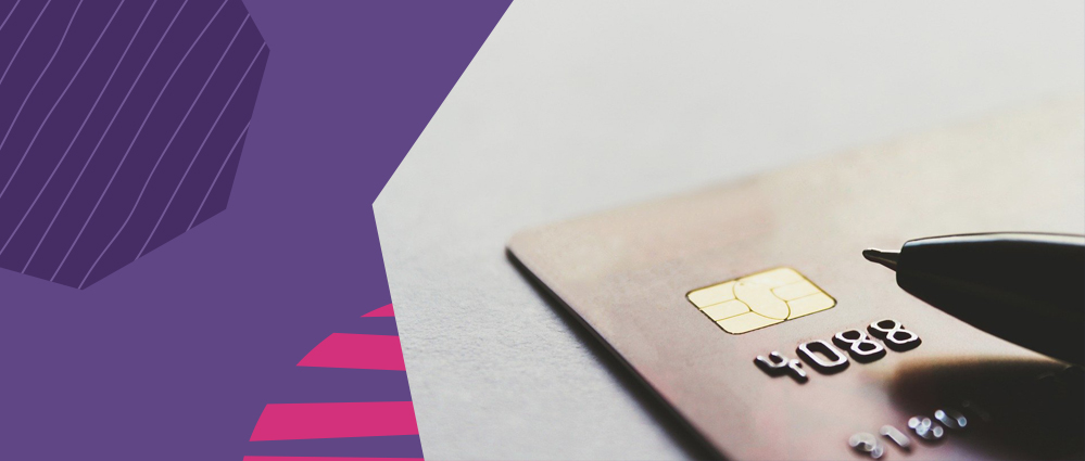 A photo of a black pen on top of a debit card with WorldRemit purple background