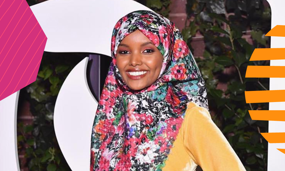 "Halima Aden a Kenyan born Somalian and a fashion model posing in a yellow dress""A"