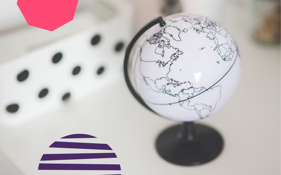 "a little white globe placed on a white desk with purple and pink vectors""A"