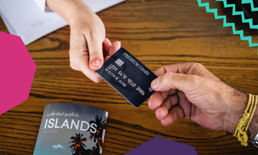 "an image showing two hands exchanging a credit card while traveling with a book on side with a title islands""A"