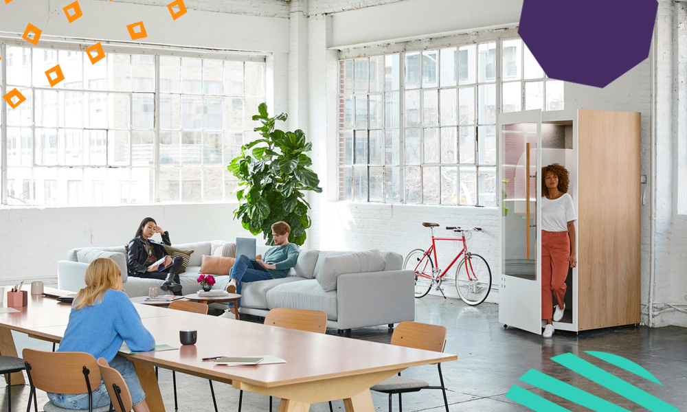 "an image of a bright workspace with four people working and standing or sitting in different places in the room""A"