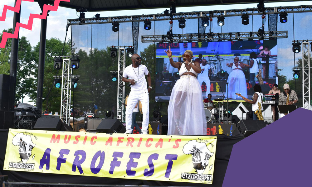 "A man and a woman singing on a stage of Toronto's Afrofest""A"