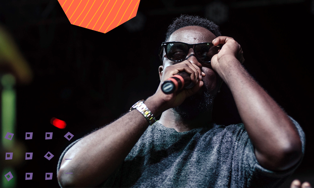 "Ghanaian rapper sarkodie rapping on a black background""A"