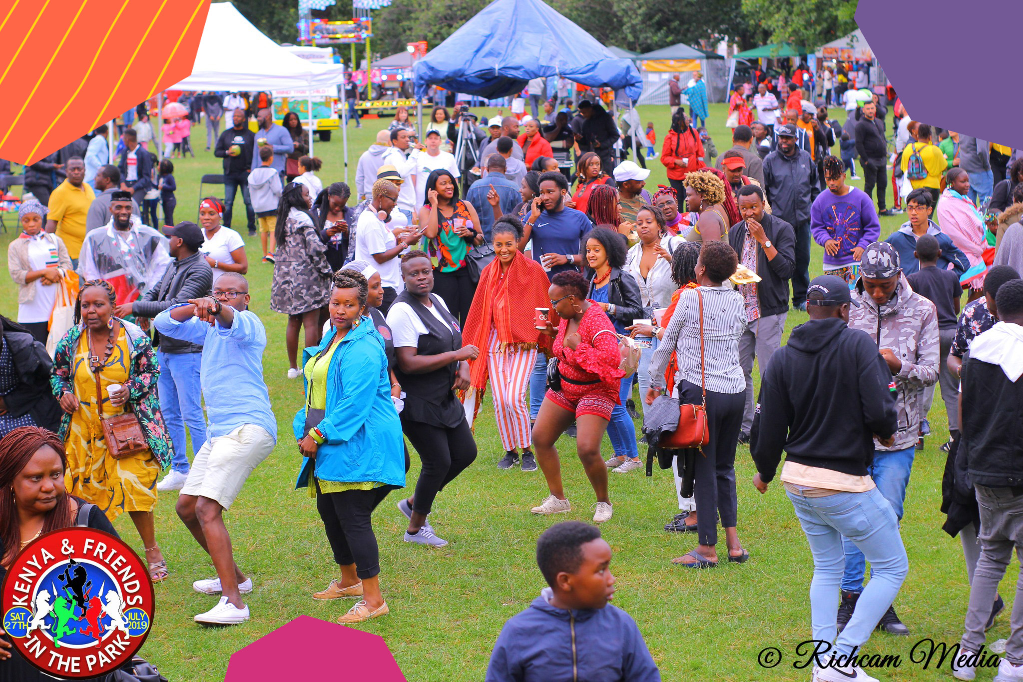 "A crowd of Kenyan people having fun in a park during a London event Kenya in the Park""A"