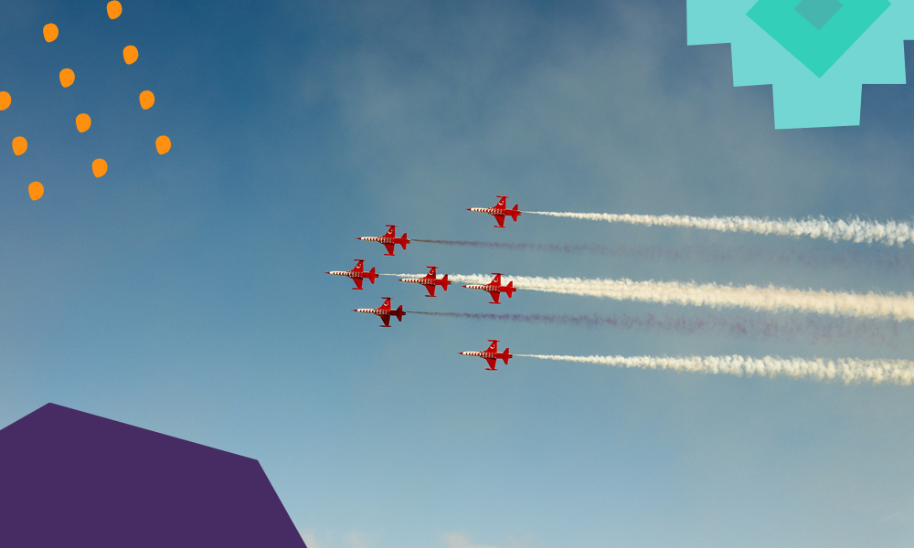 """seven planes flying in a formation on a blue sky """"A"""