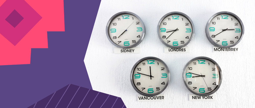set of five clocks showing different timezones hanging on a white wall