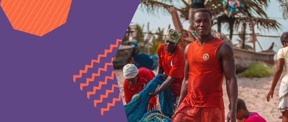 Men working on a Ghanaian beach