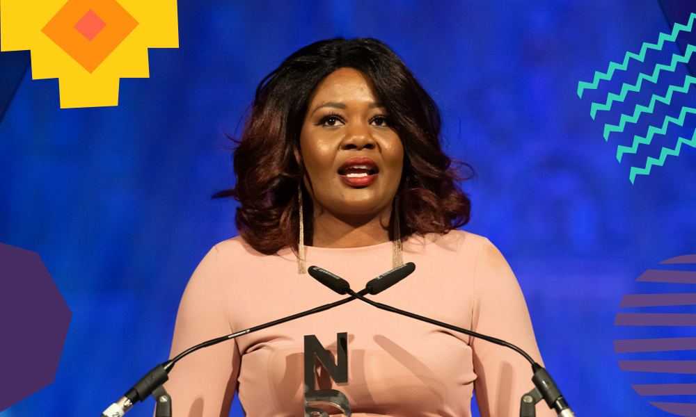 """Codilia Gapare accepting a national diversity award and giving a speech """"A"""