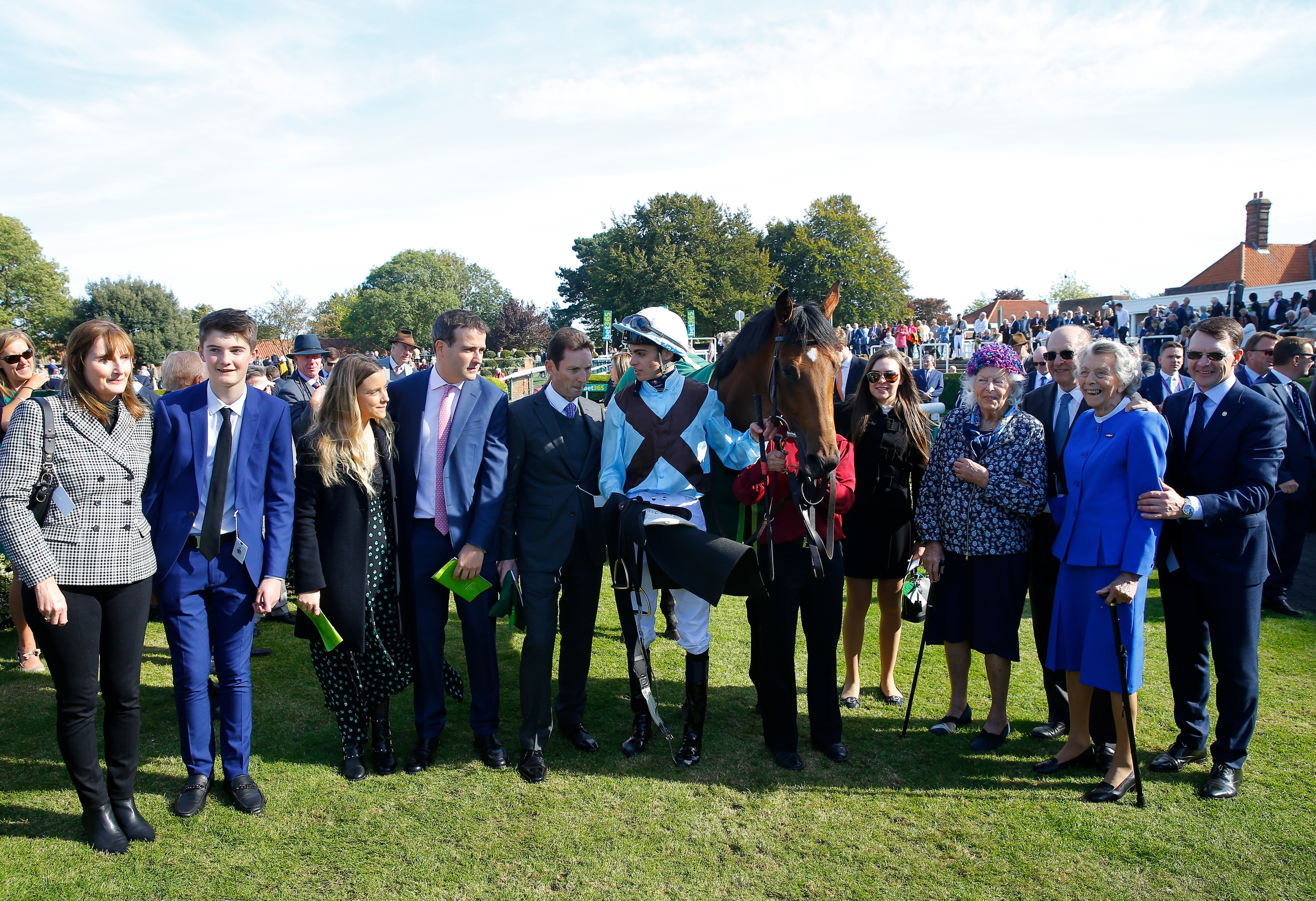 Stockwell, fourth right, in the hat, next to her sister after the victory of Fairyland in the Cheveley Park Stakes (Focusonracing)