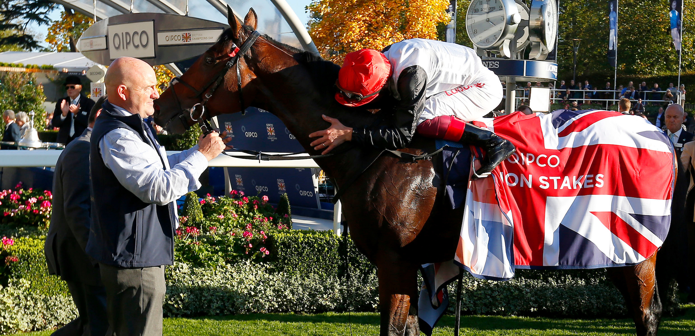 Dettori gives Cracksman a hug after his second runaway win on Champions Day (Focusonracing)