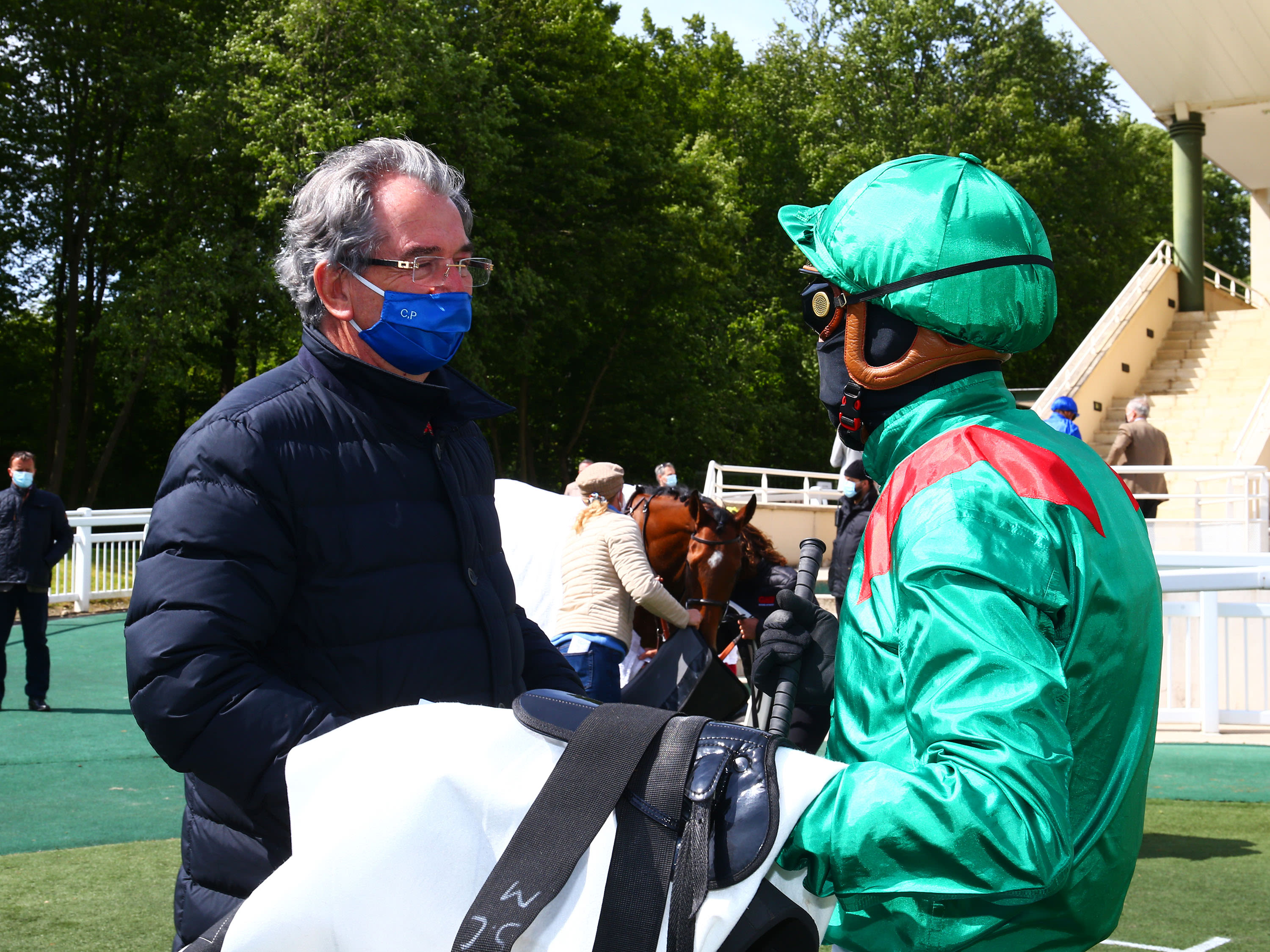 Jean-Claude Rouget and Christophe Soumillon have a debrief after a race in France this month. In Britain, jockeys and trainers will be encouraged to speak on the telephone (Fousonracing)