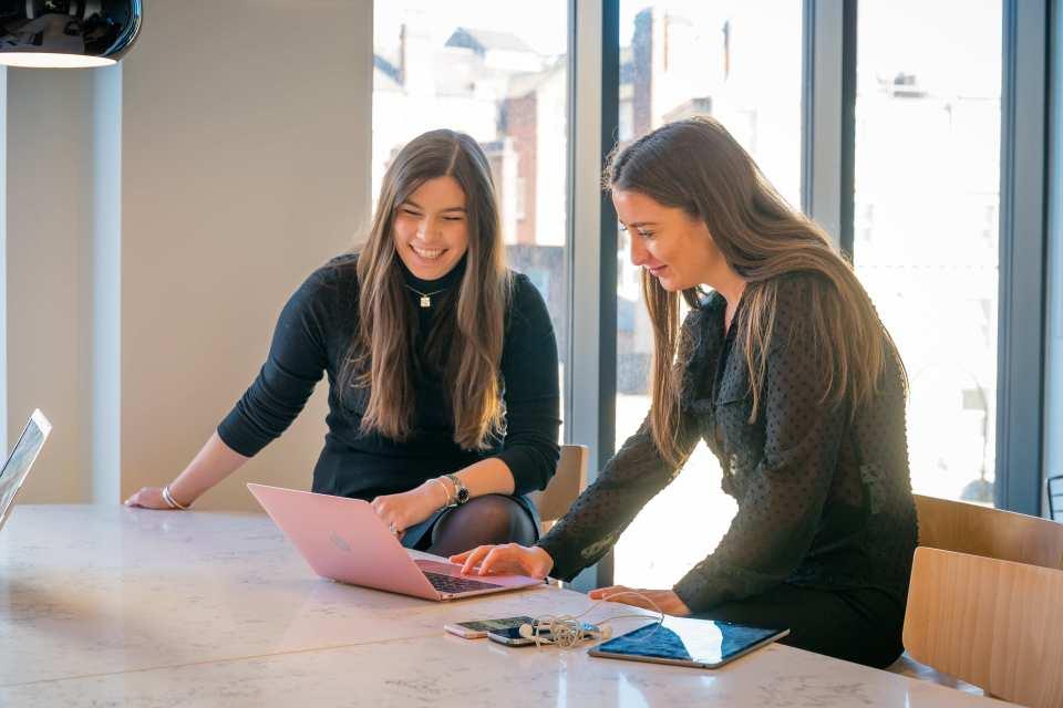 two women working at Platform