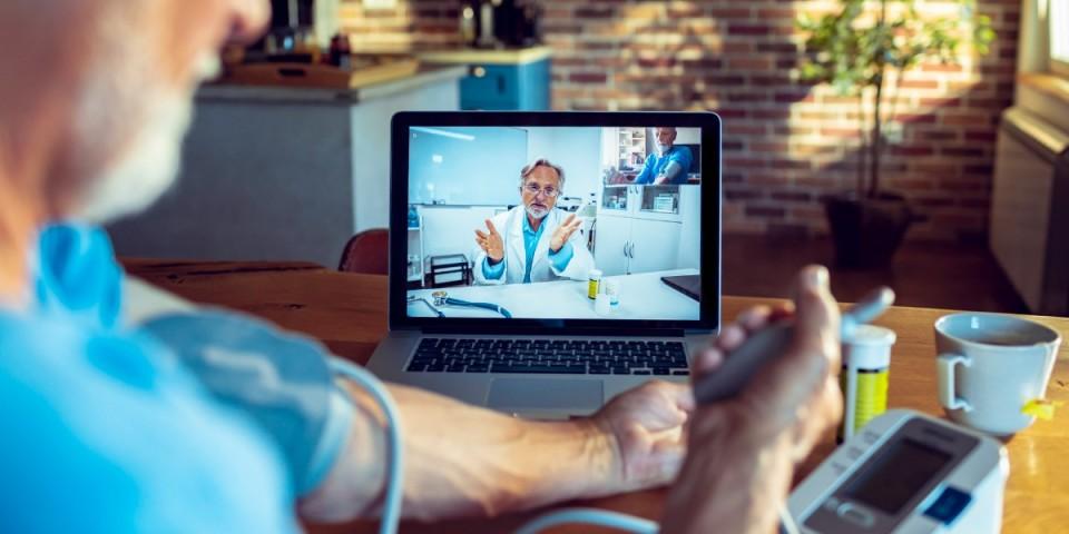 digital health doctor on laptop