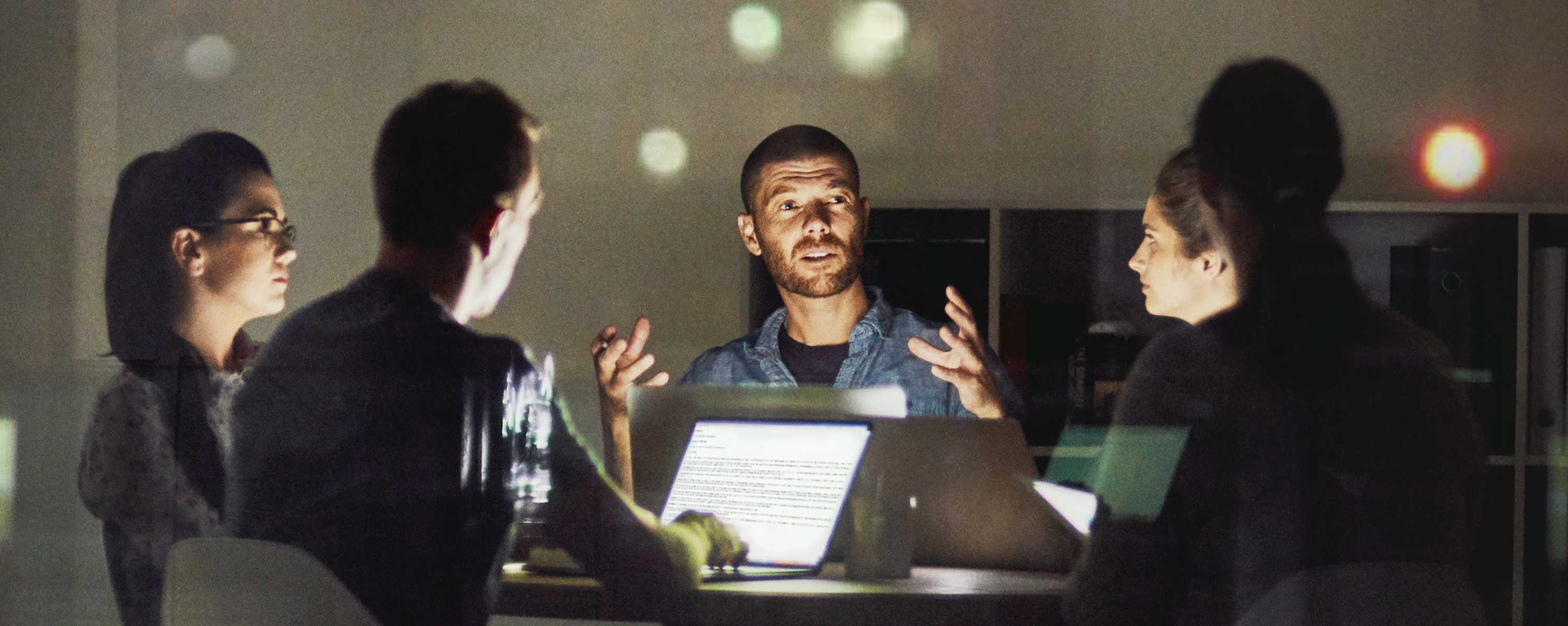 Five People Working Late in a Dark Office > Image > Blog