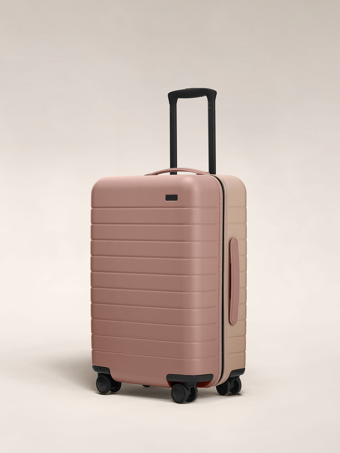 Angled view of the hardside Bigger Carry On in Dusty Rose/Taupe