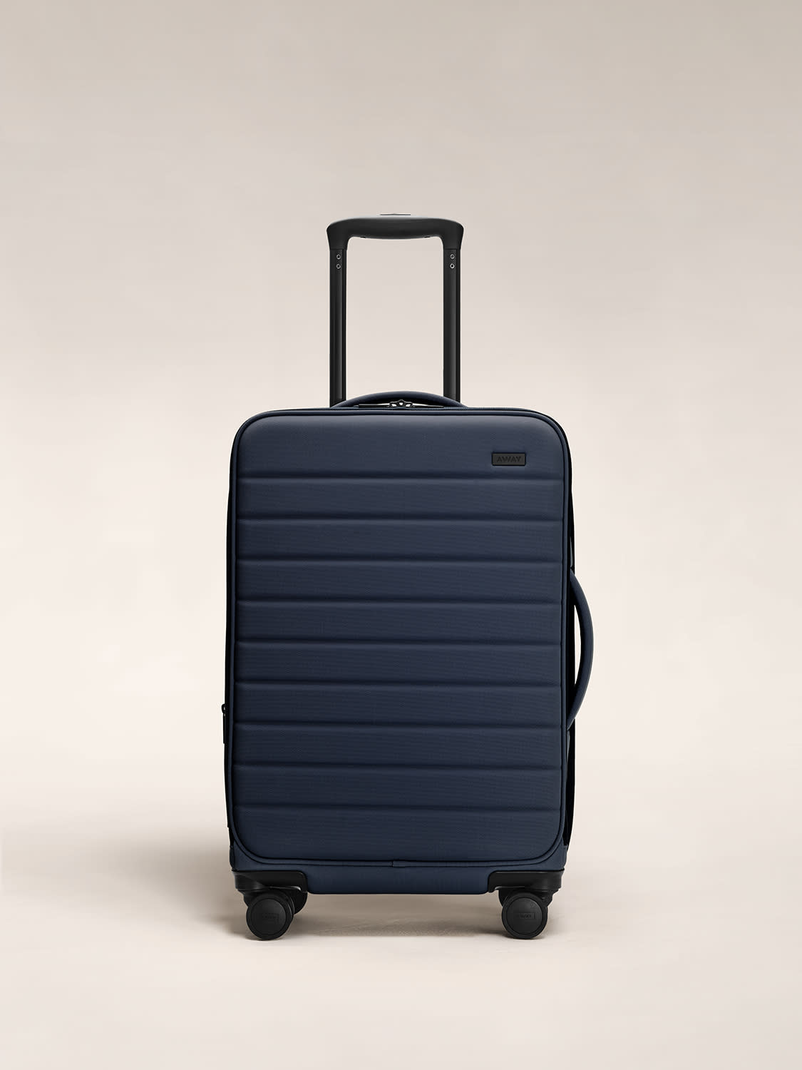 Front view of away softside bigger carry on in navy