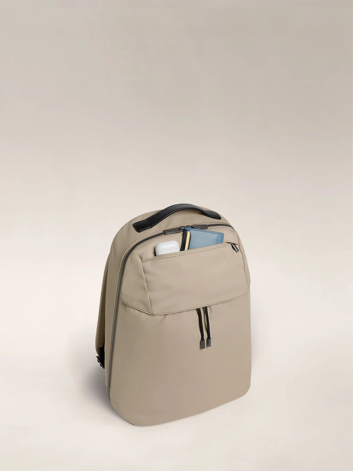 Angled view of the Flap Backpack in Sand