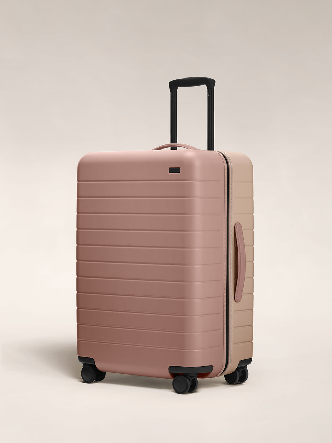Angled view of the Medium hardside suitcase in Dusty Rose/ Taupe