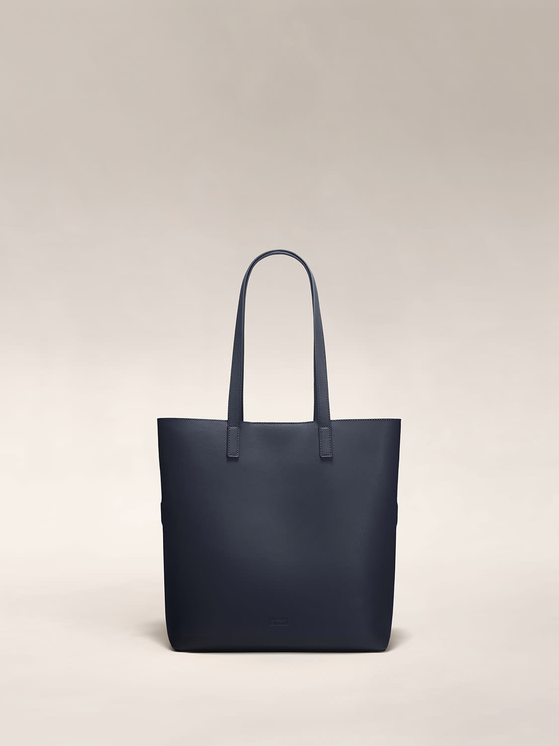 The Longitude Tote in Navy leather
