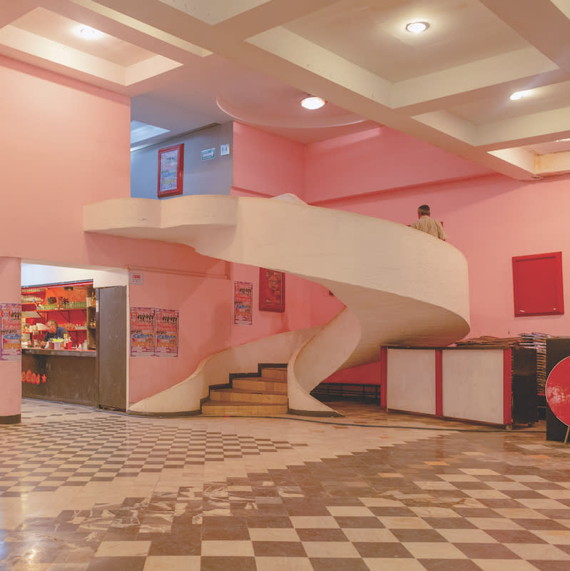 Salón Los Angeles, a cumbia dancehall in Mexico City, pink walls and a spiral white staircase.