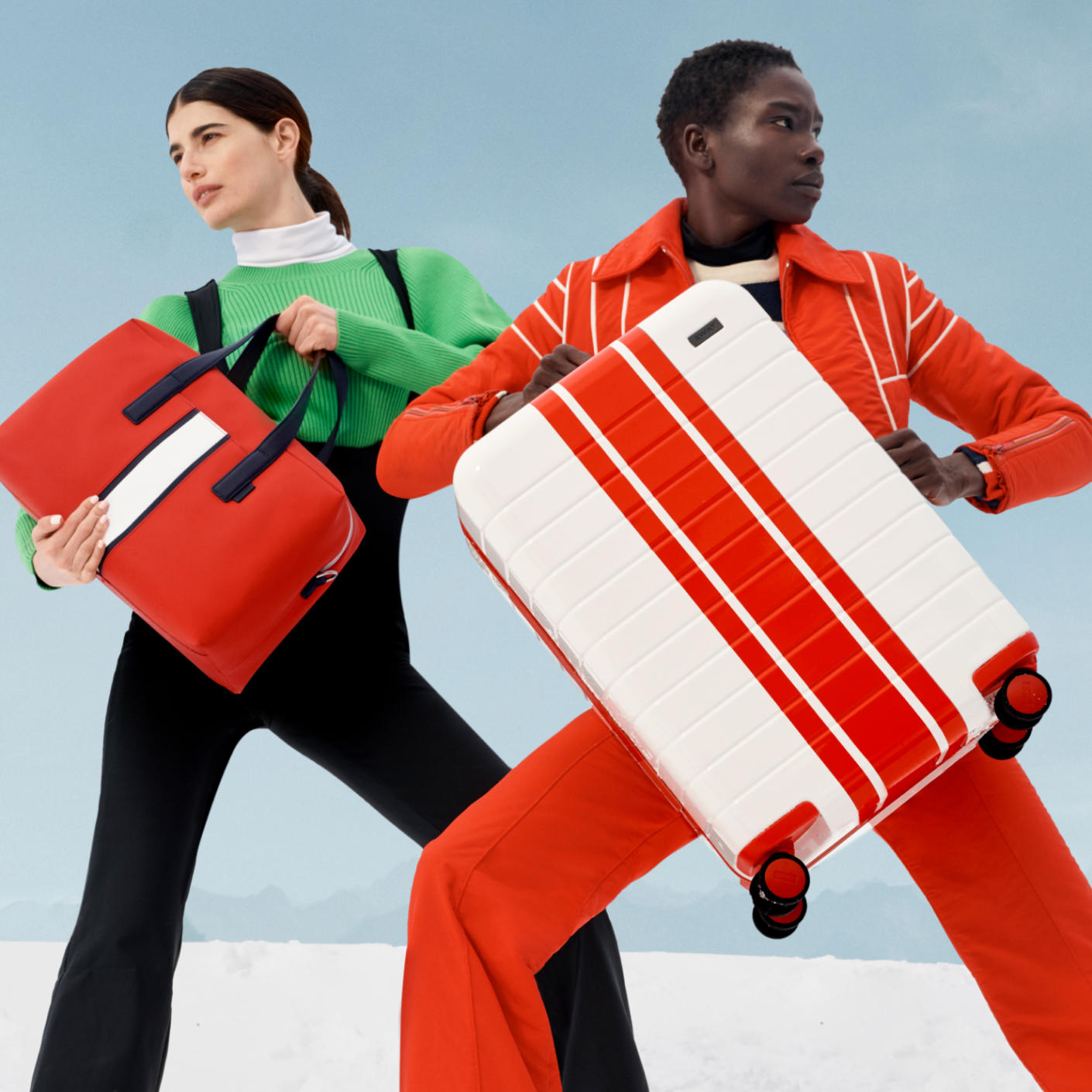 Two people, one holding a white carry-on suitcase (red stripe) and the other a red everywhere bag (white stripe).