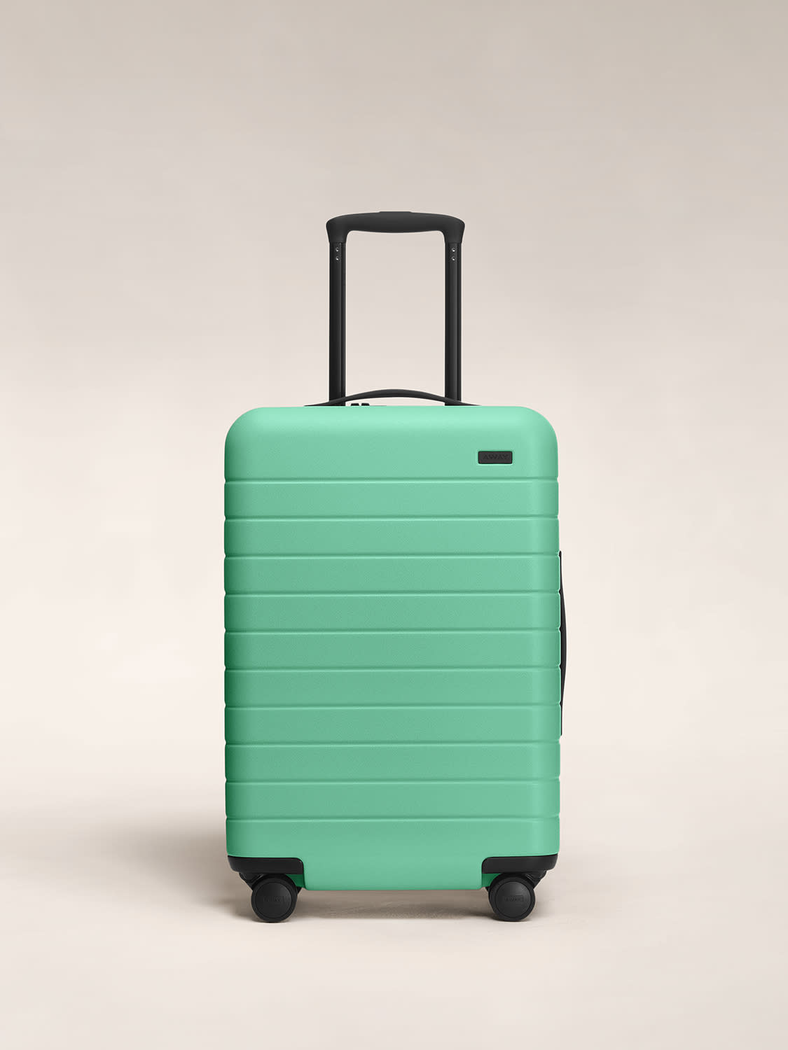 Front view of Away hardside luggage in The Bigger Carry-On size in Aqua