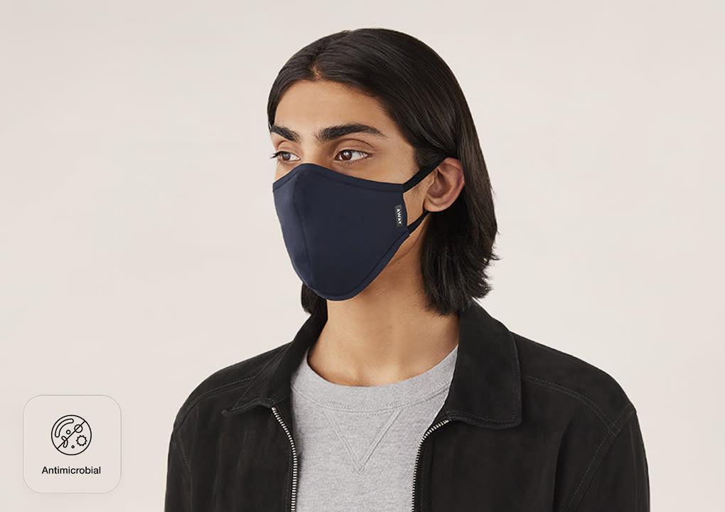A man wearing an Away reusable cloth face mask.