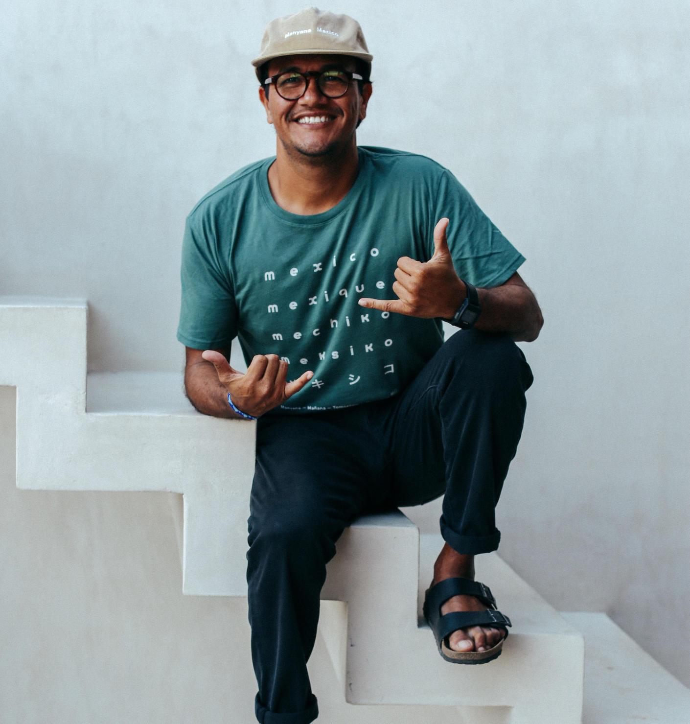 Restauranter man sitting on top of white steps Sayulita, Mexico