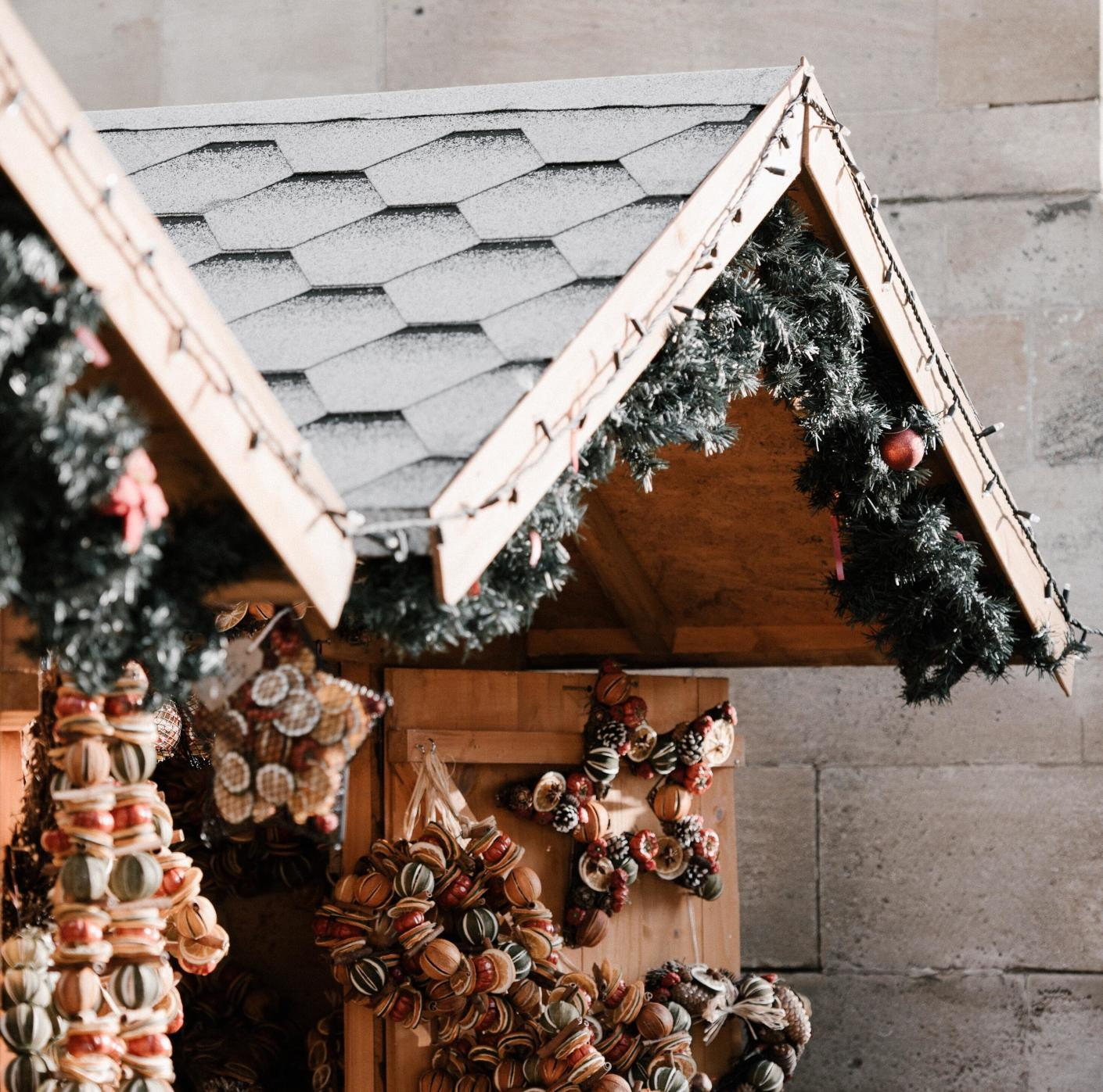 Souvenirs displayed in a close-up of a house-front in a Christmas market