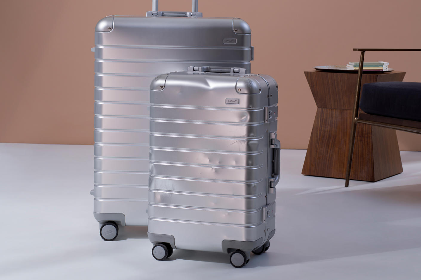 The aluminum Bigger Carry On and Large suitcases. The Bigger Carry On has dents.