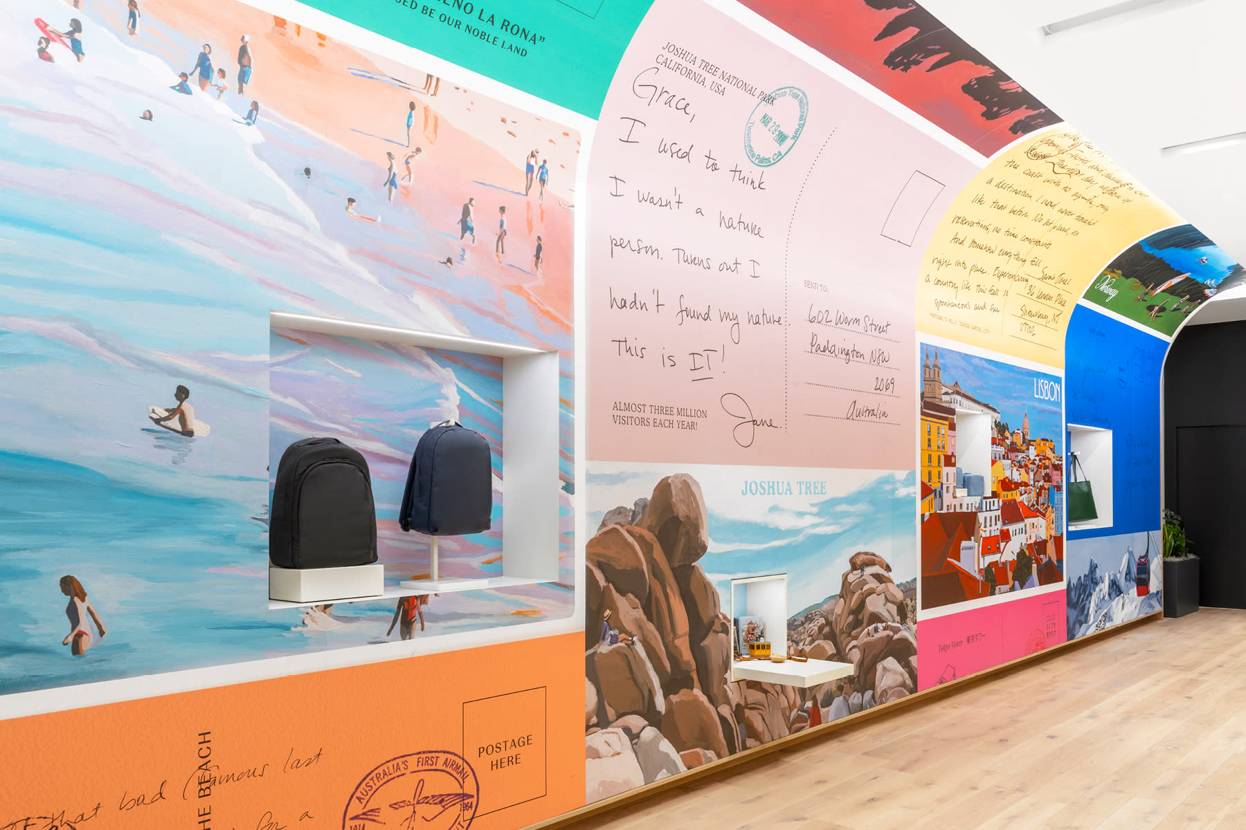 Store wall covered in colorful large-sized travel postcards.