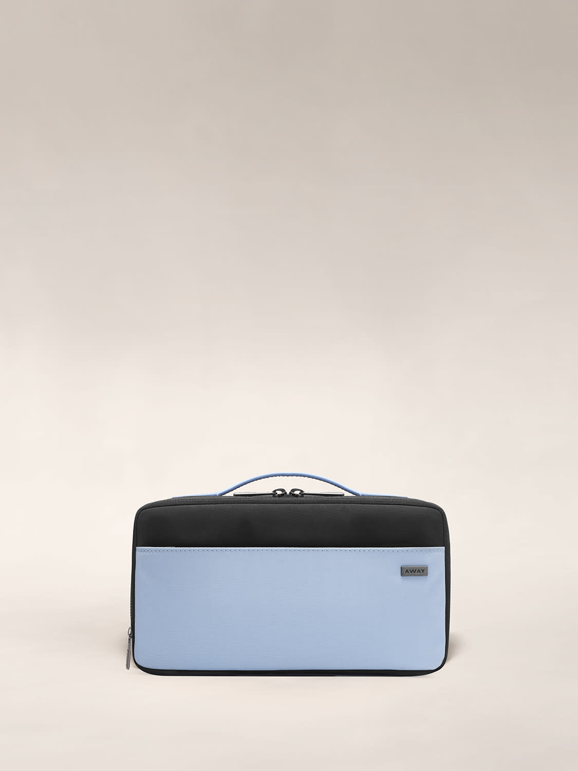Front view of the Expandable Toiletry Case in black and periwinkle