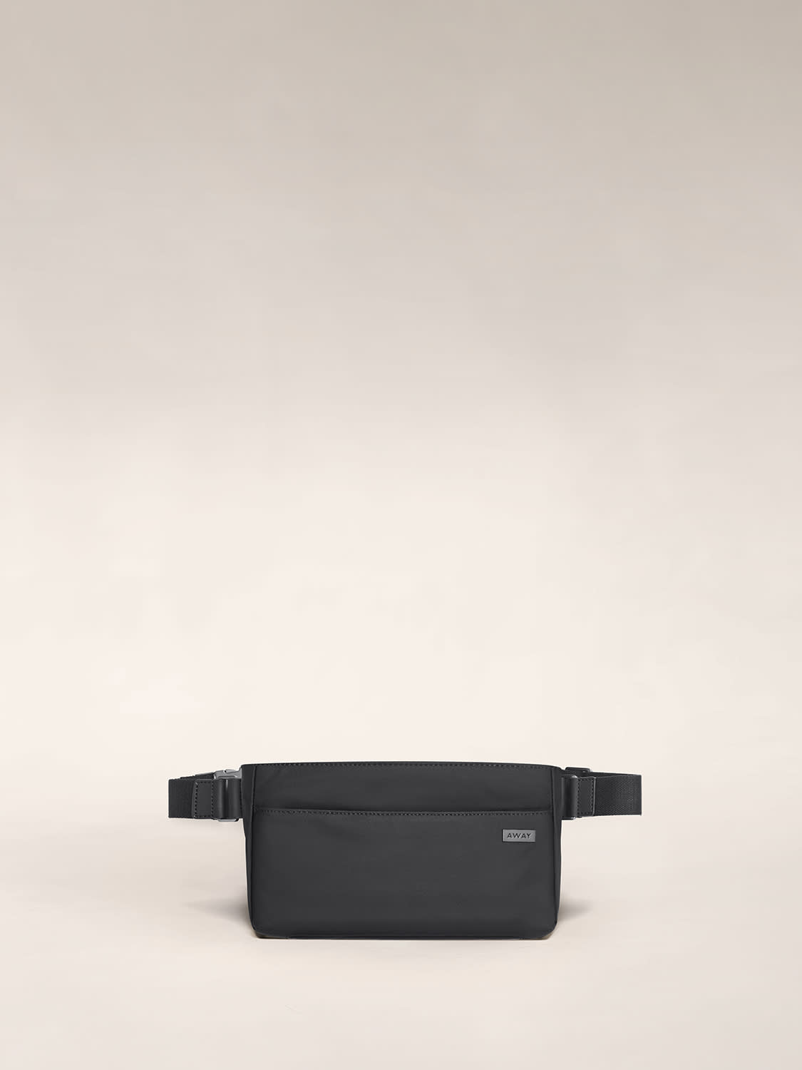 View of the front pocket of the Away sling bag in black nylon