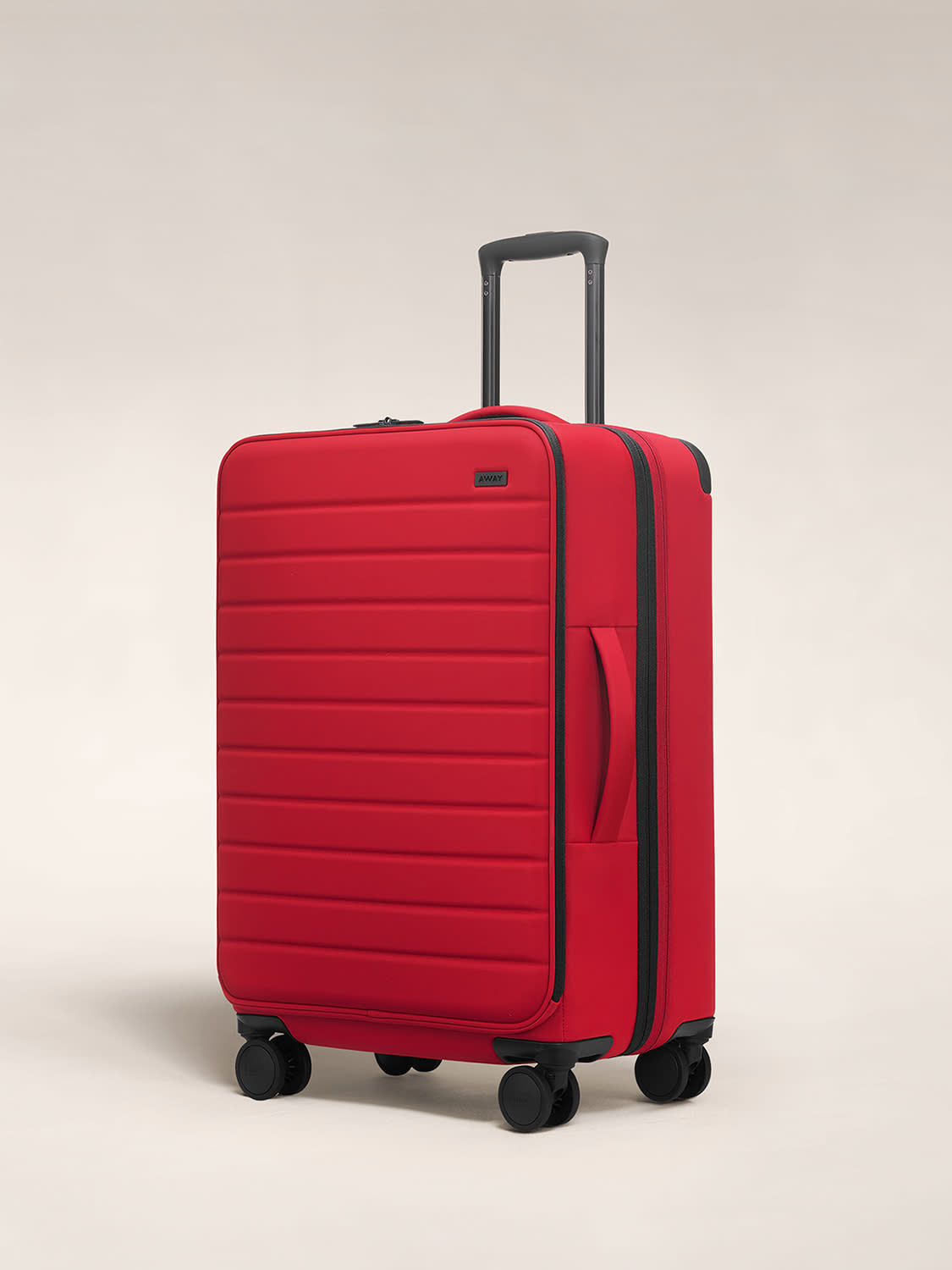 Angled view of the Away softside expandable large in rouge