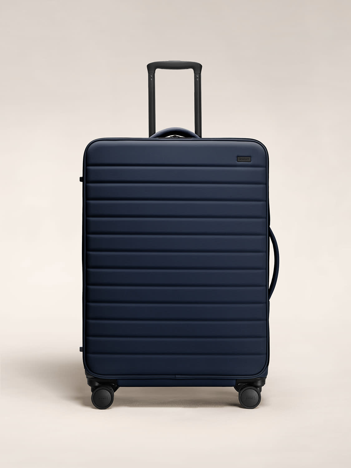Front view of the Away expandable Large softside suitcase in navy