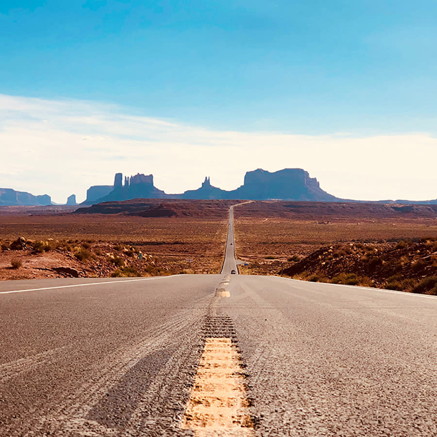 Road view of the highway leading to Navajo Nation's Monument Valley Park.