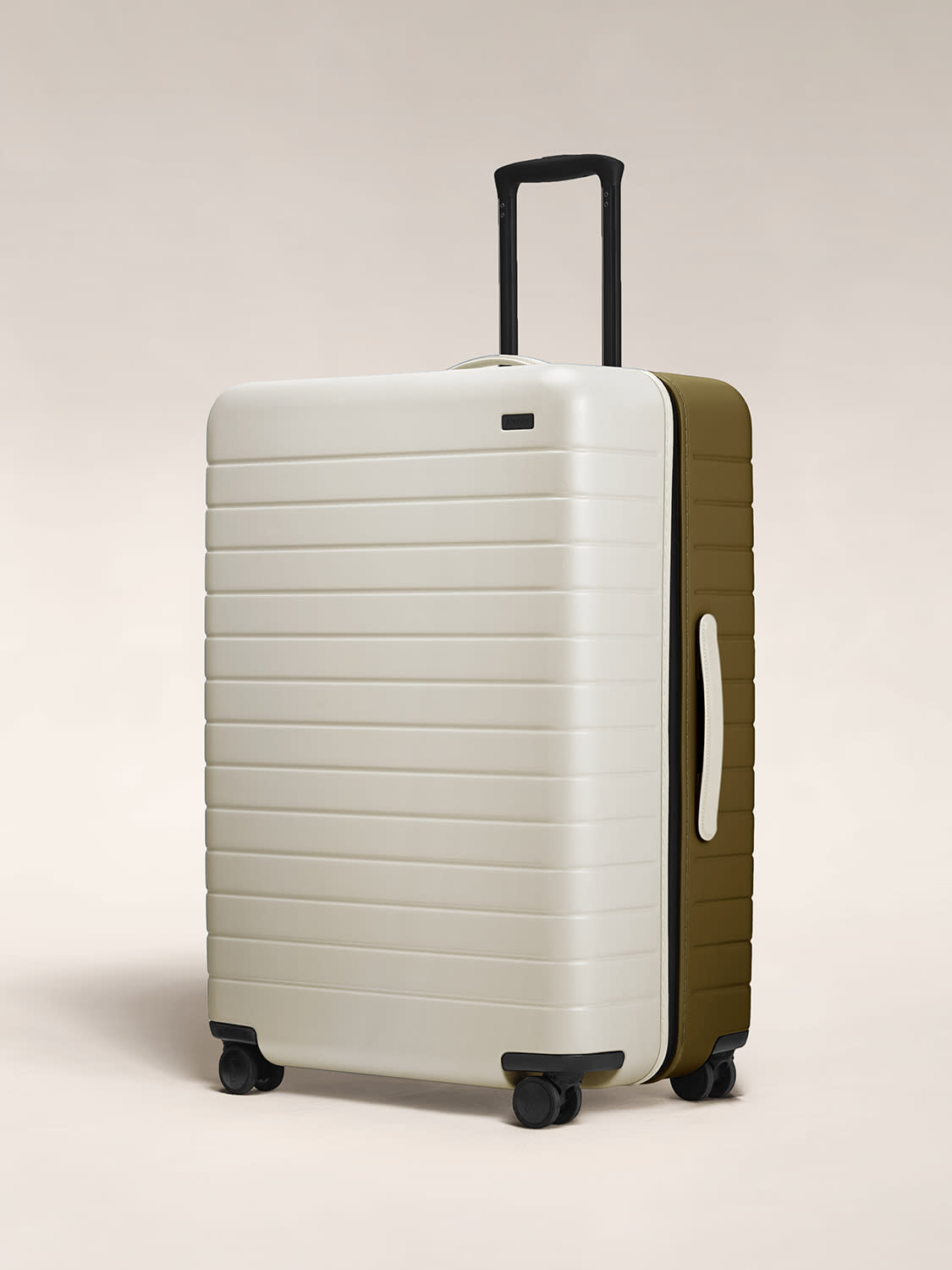 Angled view of the Large hardside suitcase in Beige/Olive