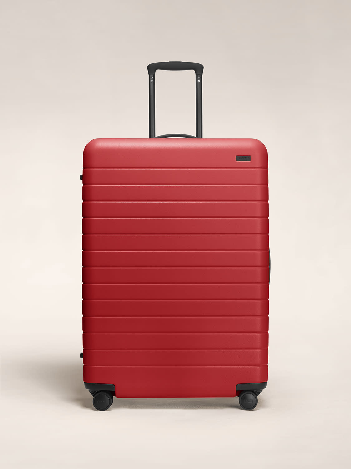 Front view of Away hardside Large luggage in rouge