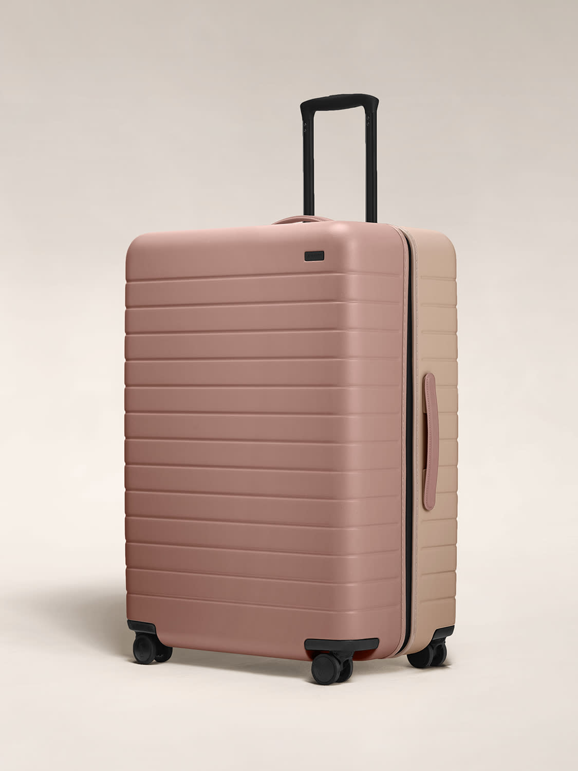 Angled view of the Large hardside suitcase in Dusty Rose/ Taupe