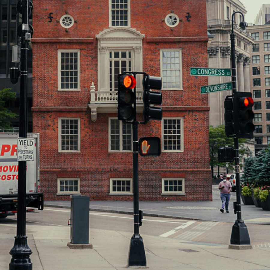Historic buildings in the background at the traffic lights intersection of Congress St. and Devonshire St., Boston.