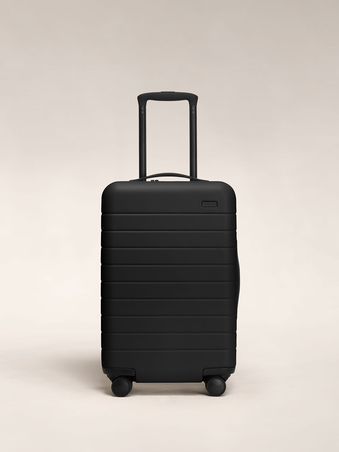 Front view of The Carry On hardside luggage in black
